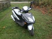 Продам скутер 150 см3, в отличном состоянии, чёрно-серебристый.